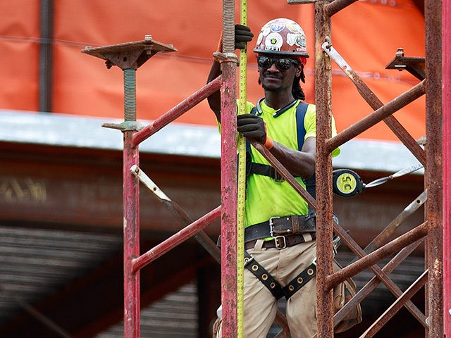 NEW YORK, NY - AUGUST 16: A construction laborer works on the site of a new residential building in the Hudson Yards development, August 16, 2016 in New York City. Home construction in the U.S. accelerated in July to the fastest pace in five months. While housing starts were up …