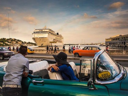 Cubans observe the arrival of a cruise ship bringing tourists to Havana, on January 18, 2017. / AFP / ADALBERTO ROQUE (Photo credit should read ADALBERTO ROQUE/AFP/Getty Images)