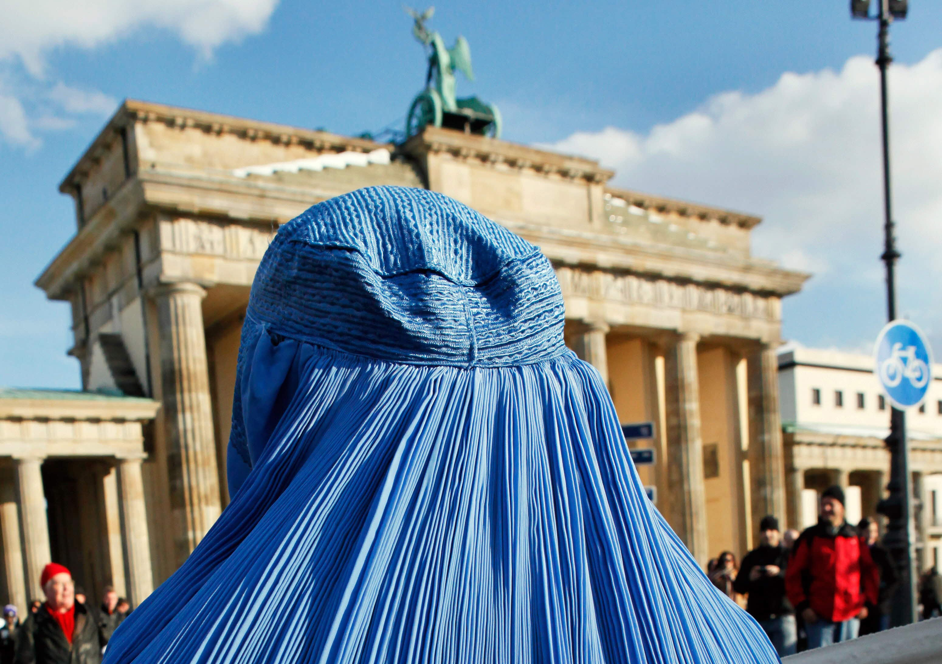 (FILES) Picture taken on February 20, 2010 shows a woman wearing a burka during a demonstration against the German Bundeswehr army's deployment in Afghanistan in front of the Brandenburg Gate in Berlin.