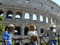 Street vendors wait for tourists to sell hats near the Colosseum on June 21, 2017 in Rome. In Italy, forecasters say the current heatwave could turn out to be the most intense in 15 years, with temperatures around eight degrees above the seasonal average -- 39 degrees Celsius in Milan …