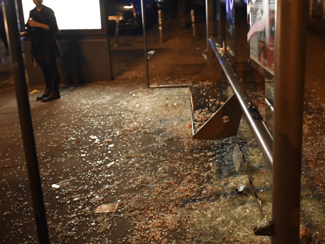 HAMBURG, GERMANY - JULY 07 : Smashed glass of a bus stop is left by left-wing protestors during a march on July 7, 2017 in Hamburg, Germany. Leaders of the G20 group of nations are arriving in Hamburg today for the July 7-8 economic summit and authorities are bracing for …