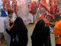 Saudi women buy halal meat