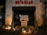 A picture taken on November 13, 2017 shows lightened candles, flowers and messages at a makeshift memorial around the commemorative plaque outside the Bataclan concert hall in tribute of the victims of the attack on the Bataclan in which 90 people were killed on November 13, 2015. France on November …