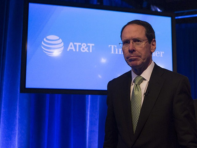 NEW YORK, NY - NOVEMBER 20: AT&T Chairman and CEO Randall Stephenson and AT&T Senior Executive Vice President David R McAtee II leave after a news conference in Time Warner headquarters addressing the latest developments in the AT&T and Time Warner merger on November 20, 2017 in New York City. …