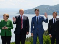 LA MALBAIE , QC - JUNE 08: German Chancellor Angela Merkel, US President Donald Trump, Canada's Prime Minister Justin Trudeau and , French President Emmanuel Macron wave during the Family photo on the first day of the G7 Summit, on 8 June, 2018 in La Malbaie, Canada. Canada will host …