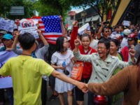 Vietnamese protesters shout slogans against a proposal to grant companies lengthy land leases during a demonstration in Ho Chi Minh City on June 10, 2018. - The draft law at the centre of the furore would allow 99-year concessions in planned special economic zones, which some view as sweetheart deals …