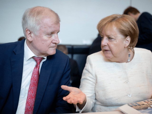 Merkel on tightrope over disputed migrant policy