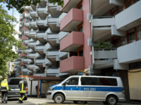 A police car stands on June 15, 2018 in front of an apartment building in Cologne's Chorweiler district, where a Tunisian suspected of trying to build a biological weapon was arrested three days before. - The 29-year-old man, identified as Sief Allah H, was detained after police stormed his flat …