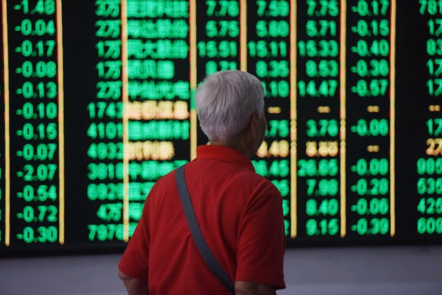 HANGZHOU, CHINA - JUNE 19: An investor watches the electronic board at a stock exchange hall on June 19, 2018 in Hangzhou, China. Chinese shares plunged on Tuesday with the benchmark Shanghai Composite Index down 114.08 points, or 3.78 percent, to close at 2,907.82. The Shenzhen Component Index fell 528.37 …