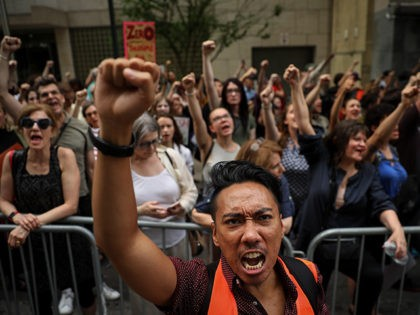 NEW YORK, NY - JUNE 20: Activists shout toward the U.S. Mission to the United Nations while rallying in support immigrants and to mark World Refugee Day, June 20, 2018 in New York City. Bowing to political pressure from both parties, President Donald Trump signed an executive order on Wednesday …