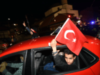 Turkish nationals, supporters of president Recep Tayyip Erdogan, currently residing in Bosnia and Herzegovina, cheer in downtown Sarajevo, late on June 24, 2018. - After 15 years in office that have already transformed his country, President Recep Tayyip Erdogan is set to return to power aiming to establish himself alongside …