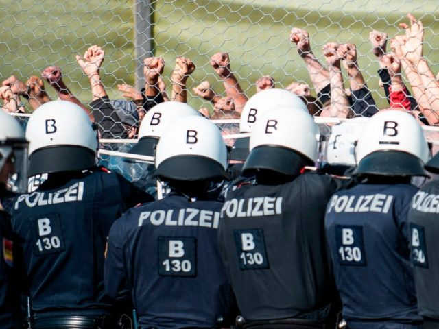 "New border patrol police unit called Puma as well as performers of ""strangers"" take part in the exercise ""ProBorders"" at the Spielfeld border crossing in Austria on June 26, 2018. - Several hundred Austrian police and soldiers on June 26, 2018 simulated a border control exercise at the crossing point …"