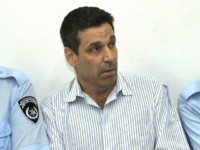 Former Israeli energy minister Gonen Segev (C) appears at the Tel Aviv district tribunal 22 April 2004. Segev was remanded in custody after having been arrested on suspicion of attempted drug-trafficking. The court ordered that Segev remain in custody until April 28. Segev, who had served as a minister in …
