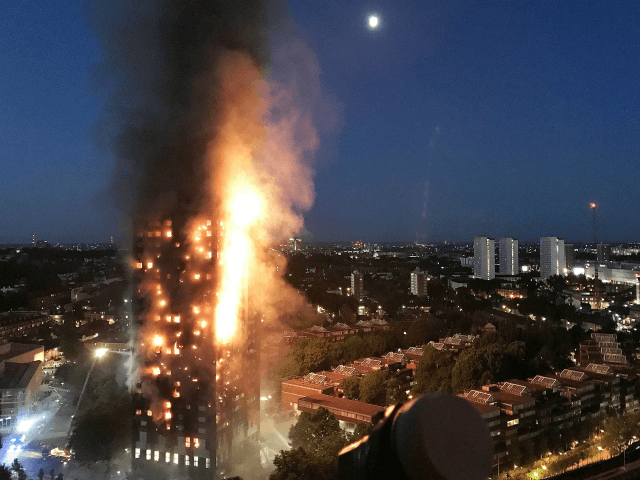 LONDON, ENGLAND - JUNE 14: In this image taken by eyewitness Gurbuz Binici, a huge fire engulfs the 24 story Grenfell Tower in Latimer Road, West London in the early hours of this morning on June 14, 2017 in London, England. The Mayor of London, Sadiq Khan, has declared the …
