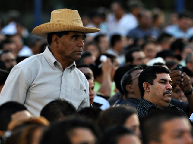 Supporters of Nicaraguan President Daniel Ortega attend a ceremony marking the start of his last year in power, at the Revolution square in Managua on January 10, 2011. AFP PHOTO/Elmer MARTINEZ (Photo credit should read ELMER MARTINEZ/AFP/Getty Images)