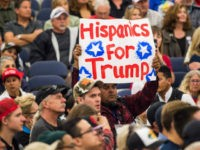 A man holds a sign reading 'Hispanics For Trump' at a campaign rally of the presumptive Republican presidential candidate Donald Trump on May 25, 2016 in Anaheim, California. Donald Trump said that if he is elected US president he would support the Canadian Keystone oil pipeline project that was blocked …