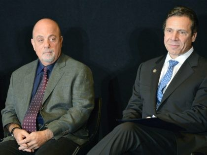New York Governor Andrew Cuomo (L) and musician Billy Joel attend Madison Square Garden's announcement of Billy Joel as their first-ever music franchise and add May 9th show with exclusive pre-sale for Citi customers at Madison Square Garden on December 3, 2013 in New York City. (Photo by Slaven Vlasic/Getty …