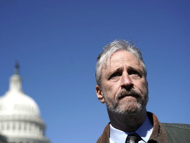 Comedian Jon Stewart talks to a member of the media after a news conference March 5, 2018 on Capitol Hill in Washington, DC. Stewart took part in a news conference to urge White House Budget Director Mick Mulvaney not to cut the World Trade Center Health Program, which provides medical …