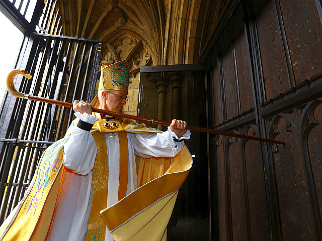 CANTERBURY, ENGLAND - MARCH 21: The Most Reverend Justin Welby, strikes three times on the West Door of Canterbury Cathedral with his pastoral staff prior to his enthronement service to become Archbishop of Canterbury at Canterbury Cathedral on March 21, 2013 in Canterbury, England. The newly appointed Archbishop of Canterbury …