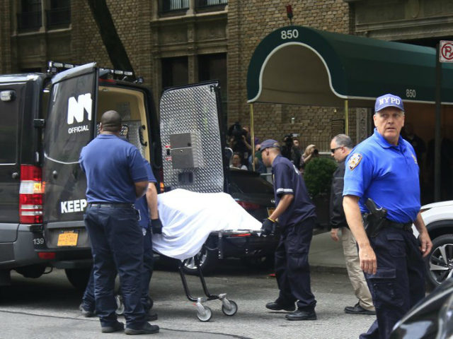 The body of fashion designer Kate Spade is removed from her Park Avenue apartment Tuesday, June 5, 2018 in New York. Law enforcement officials say Spade apparently hanged herself in the bedroom of her apartment. The officials say she was found by housekeeping staff and left a note at the …