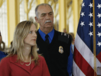 Homeland Security Director Michael Chertoff gestures during a news conference at Washington's Ronald Reagan National Airport, Wednesday, Oct. 22, 2008. At left is Deputy Assistant Secretary for Policy Kathy Kraninger, and second right is Transportation Safety Administrator Kip Hawley. (AP Photo/Gerald Herbert)