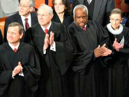 WASHINGTON - FEBRUARY 24: (L-R) Supreme Court Chief Justice John Roberts joins Justice Anthony Kennedy, Justice Clarence Thomas, and Justice Ruth Bader Ginsburg in applauding the arrival of U.S. President Barack Obama prior for a joint meeting of the U.S. Congress February 24, 2009 at the U.S. Capitol in Washington, …