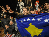 Kosovars celebrate the independence of Kosovo as they displays the contry's new flag in the center of the capital Pristina on February 17, 2008. Kosovo's parliament declared the province's independence from Serbia, giving Europe a new nation and marking an historic turning point in the volatile Balkans. Serbian newspapers in …