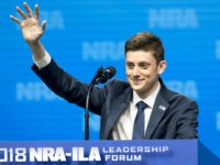 Kyle Kashuv, a student from Stoneman Douglas High School, waves as he arrives to speak at the National Rifle Association Institute for Legislative Action (NRA-ILA) Leadership Forum during the NRA annual meeting in Dallas, Texas, U.S., on Friday, May 4, 2018. President Donald Trump delivered a strong sign of support for the …