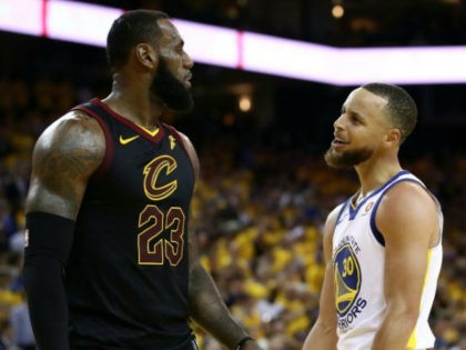 Stephen Curry #30 of the Golden State Warriors exchanges words with LeBron James #23 of the Cleveland Cavaliers in overtime during Game 1 of the 2018 NBA Finals at ORACLE Arena on May 31, 2018 in Oakland, California. NOTE TO USER: User expressly acknowledges and agrees that, by downloading and …