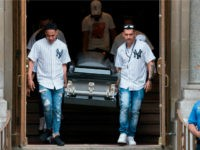 The body of Lesandro Guzman-Feliz is taken from the Our Lady of Mount Carmel church after funeral services on June 27, 2018 in New York. - Lesandro Guzman-Feliz, 15, was stabbed to death outside a Bronx bodega in an apparent case of mistaken identity. (Photo by Don EMMERT / AFP) …