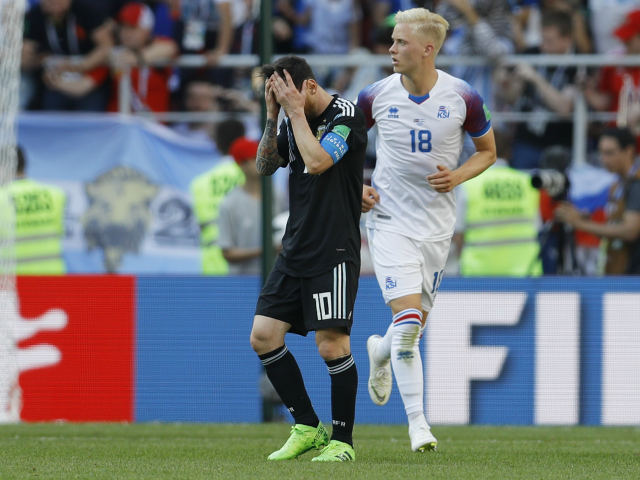 Argentina's Lionel Messi, left, reacts after missing to score during the group D match between Argentina and Iceland at the 2018 soccer World Cup in the Spartak Stadium in Moscow, Russia, Saturday, June 16, 2018. (AP Photo/Victor Caivano)