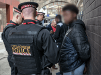 LONDON, ENGLAND - JULY 12: (EDITORS NOTE: Part of this image has been pixellated to obscure identity) Suspects are detained and searched by police officers after being arrested for alleged possession of a dangerous weapon near Elephant and Castle Station during Operation Sceptre on July 12, 2017 in London, England. …