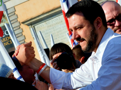 Northern League party leader Matteo Salvini shakes hands during a rally in Rome February 28, 2015. The leader of Italy's right-wing Lega Nord party, Matteo Salvini, held a protest against the policy of Prime Minister Matteo Renzi's government. At the same time, left-wing movements and associations held a 'Mai con …
