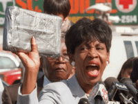 U.S. Representative Maxine Waters holds up a package 07 October similiar to those that she claims held crack cocaine that was sold on the streets of South Central Los Angeles by CIA operatives to finance the Contra rebels in Nicaragua in the 1980's. Waters presented documentation to the press at …