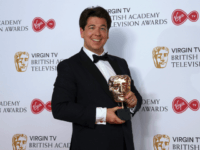 Comedian Michael McIntyre poses with his Bafta for Best Entertainment Performance at the British Academy Television Awards at the Royal Festival Hall in London, Sunday, May 14, 2017. (Photo by Joel Ryan/Invision/AP)