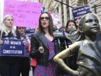 NEW YORK, NY - JUNE 4: Alyssa Milano, US Congresswoman Carolyn Maloney (D-NY) and the ERA Coalition call for ratification of the Equal Rights Amendment (H.J. Res. 33) at a press conference in front of the 'Fearless Girl' statute in Wall Street in New York, New York on June 4, …