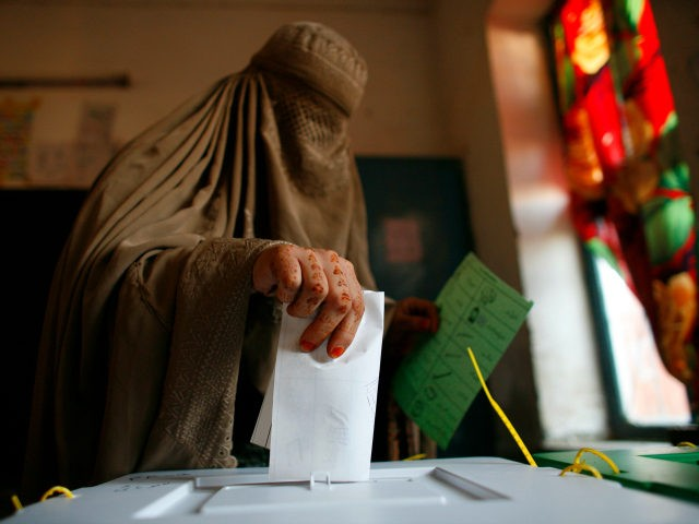 A Pakistani woman in a burqa casts her ballot on February 18, 2008 in Peshawar, Pakistan. The critical national and provincial elections are expected to further weaken President Musharraf's hold on power. The elections are considered a crucial step in the ongoing process of moving Pakistan from military to civilian …