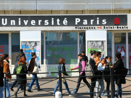 Students stand outside the Paris 8 Saint-Denis university due to a blockade of the building on April 6, 2018, in Saint-Denis, to protest against a project of selection for the admission in French universities. Students at three universities in Paris, Toulouse and Lyon blocked faculty buildings in protest at French …