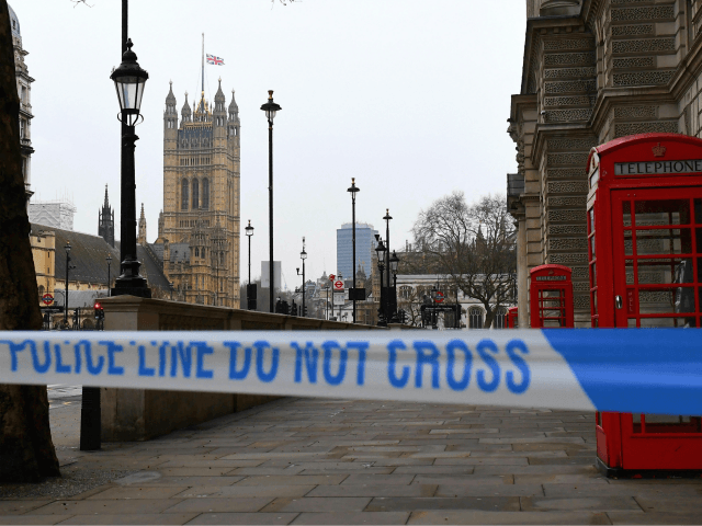 TOPSHOT - A police security cordon remains around the Houses of Parliament on March 23, 2017 in London. Seven people have been arrested including in London and Birmingham over Wednesday's terror attack at the British parliament, the police said on today, revising down the number of victims to three people. …
