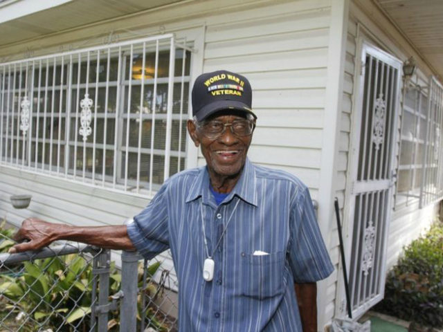Richard Overton, the oldest recorded living US veteran, surveys the backyard of his home in Austin, Texas after being presented with the Philips Lifeline with AutoAlert service on Wednesday, June 5, 2013. The medical alert service, which will help protect Overton as he continues to remain independent in his home, …