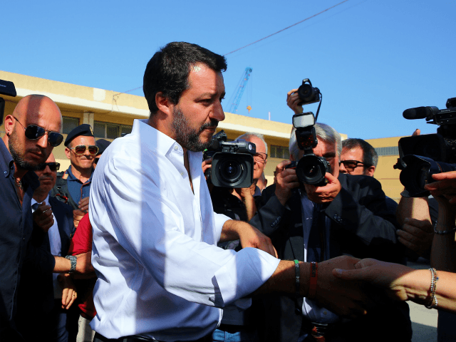 Italy's new hardline interior minister Matteo Salvini (C) arrives at the reception centre (CPSA) in Pozzallo, sicily, on June 3,2018. - The head of the far-right League is on the road seeking to rally support for his party's candidates in municipal elections later this month, as part of a broader …