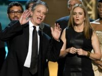 Samantha Bee and Jon Stewart appear onstage at The 2012 Comedy Awards in New York, Saturday, April 28, 2012. (AP Photo/Charles Sykes)