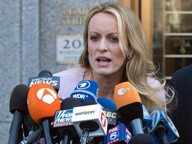 "In this April 16, 2018, file photo, adult film actress Stormy Daniels speaks outside federal court in New York. Daniels says her ex-lawyer was a ""puppet"" for President Donald Trump and worked with the president's attorney to get her to appear on Fox News and falsely deny having sex with …"