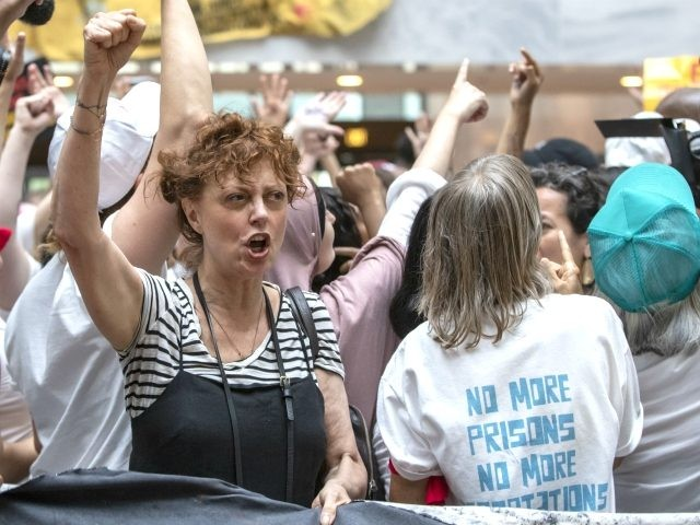 Hundreds of activists, including actress Susan Sarandon, center, protest the Trump administration's approach to illegal border crossings and separation of children from immigrant parents, in the Hart Senate Office Building on Capitol Hill in Washington, Thursday, June 28, 2018. (AP Photo/J. Scott Applewhite)