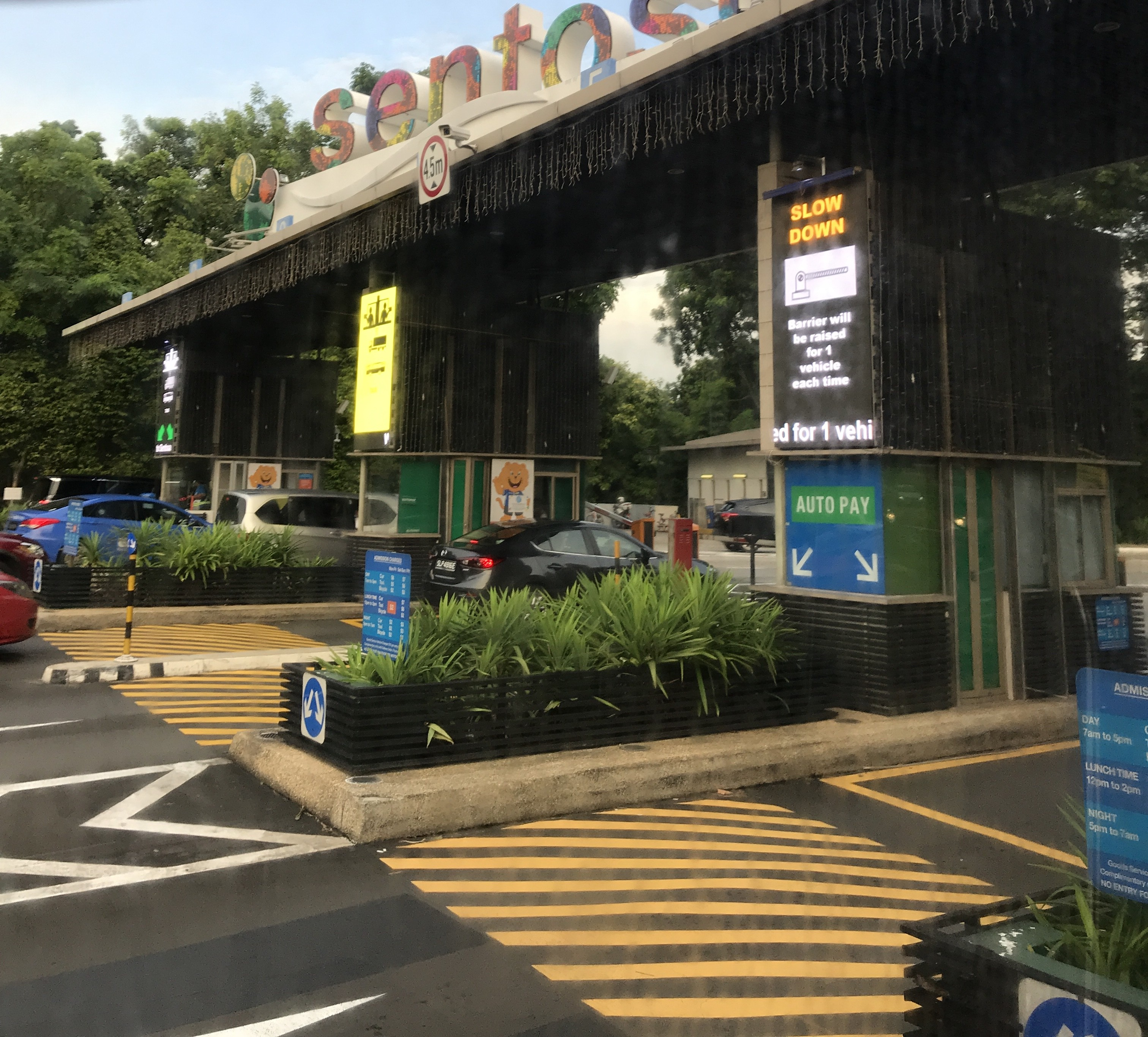 Those entering Sentosa must pass through a toll-booth. (Kristina Wong/Breitbart News)