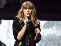 FILE - In this Dec. 8, 2017 file photo, singer Taylor Swift performs at Z100's iHeartRadio Jingle Ball at Madison Square Garden in New York. Swift surprised an 8-year-old girl at the Phoenix hospital where she has been recovering from devastating burns. The Arizona Republic reports the pop star showed …