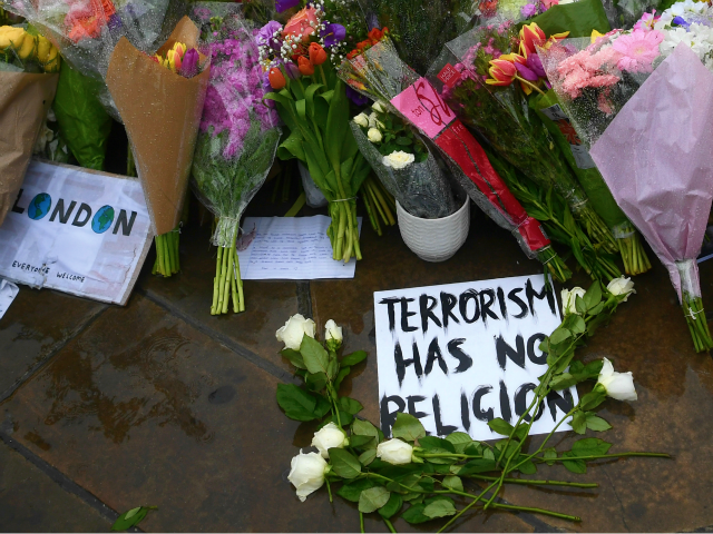 LONDON, ENGLAND - JUNE 06: Flowers and tributes are left near the scene of Saturday's terrorist attack, on June 6, 2017 in London, England. The third attacker has been named by Italian media as Youssef Zaghba a London restaurant worker, following the attack on Saturday night in London Bridge and …