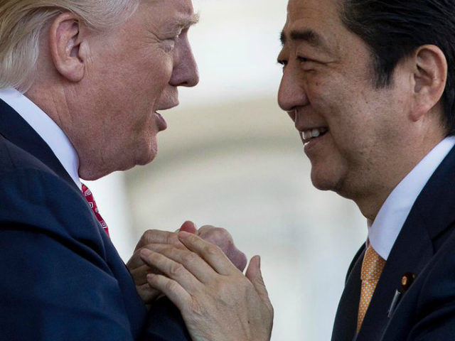 President Donald Trump welcomes Japanese Prime Minister Shinzo Abe outside the West Wing of the White House in Washington, Friday, Feb. 10, 2017. (AP Photo/Andrew Harnik)