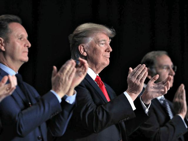 Trump Applauds