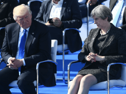 BRUSSELS, BELGIUM - MAY 25: US President Donald Trump (C) and Britain's Prime Minister Theresa May (R) look on during the NATO (North Atlantic Treaty Organization) summit ceremony at the NATO headquarters on May 25, 2017 in Brussels, Belgium.(Photo by Justin Tallis - Pool/Getty Images)